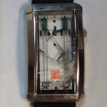 "We replaced this wristwatch crystal. Sorry, we forgot the ""after"" picture."